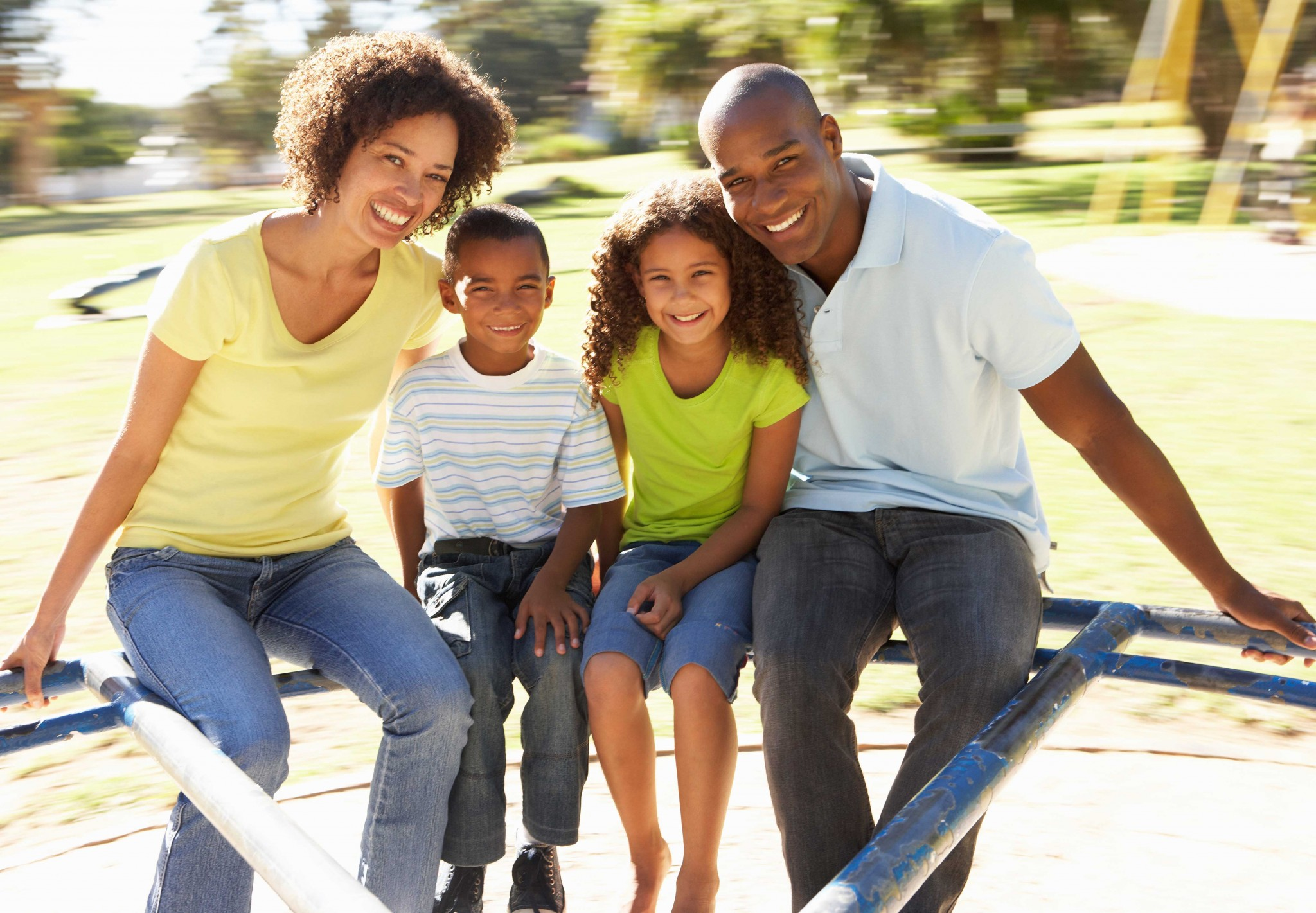 bigstock-Family-In-Park-Riding-On-Round-13919309